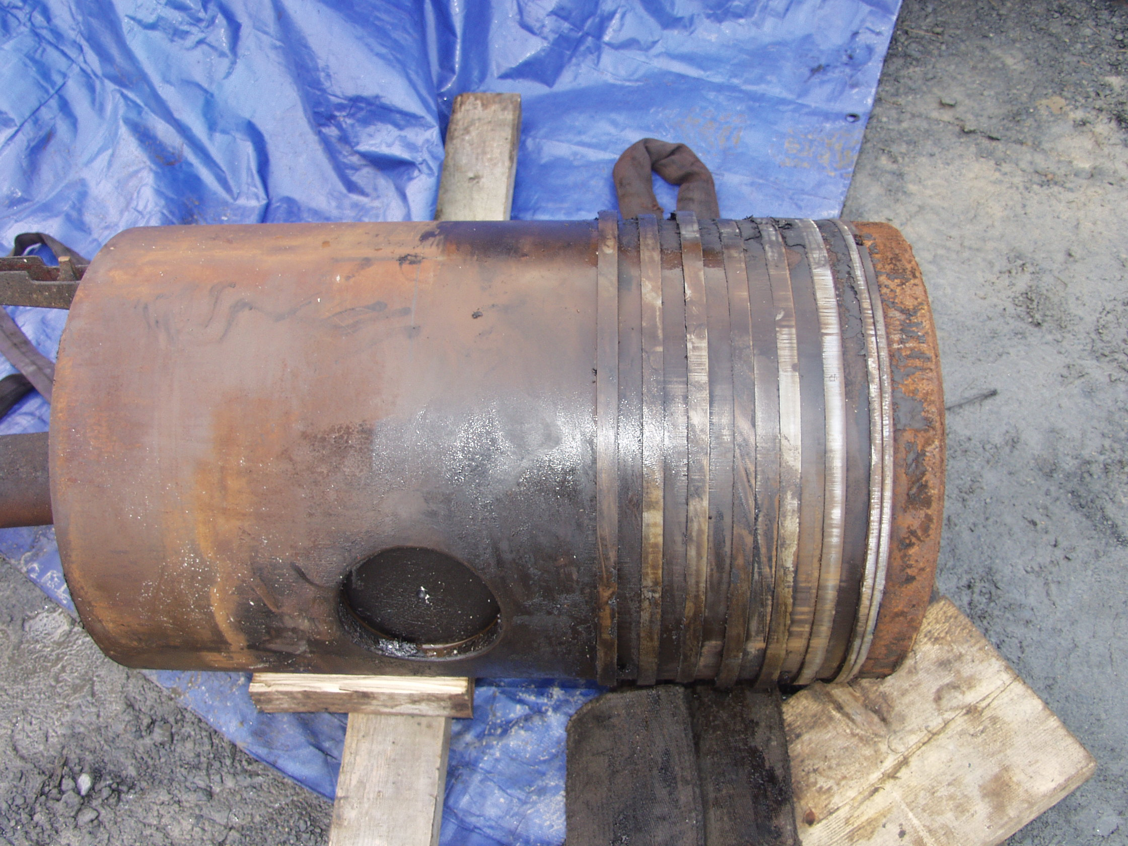 Piston and rod after removal.Required a 20 ton jack to pull out after 30 years at the top of the bore.